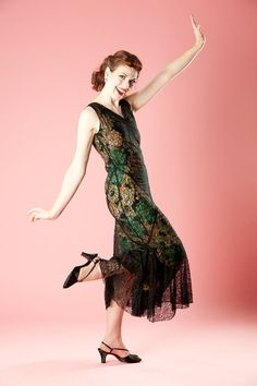 From AlexSandra's Vintage Emporium on Etsy:   Riding the line between the Roaring 20s and The Great Depression of the 1930s is this spectacular black Chantilly lace dress from Charles F. Berg in Portland, Oregon. Berg's was the first clothing shop in Portland to appeal to youth with his Chumley labeled clothing and this dress certainly embodies the younger style of the times.