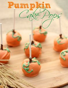 Pumpkin Cake Pops that would look cute scattered across the Thanksgiving table.