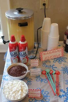 Winter wonderland Warming Station. Such a cute idea for a party or Christmas get together. And you could also do fall colors for in the fall. But I thinks id use coffee instead.
