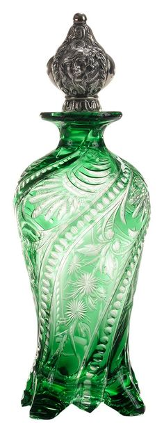 "Engraved to Colorless Crystal Perfume Bottle. English, circa 1900. graceful form, four feet, swirled ""ropes"" with stylized engraved flowers and geometric cutting, fine sterling repoussé stopper depicting Medusa with serpents, partial maker's mark, similar to Stevens & Williams Factory Pattern No. 26,240, 9-1/2 in"