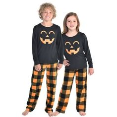 They'll be cute as a pumpkin in Jack-o'-Lantern Pajamas! The sleep set comes with a black long-sleeve with a happy Jack-o'-Lantern face printed in orange in the center. Also included are a pair of black and orange plaid pants. Halloween Pajamas, Couple Halloween Costumes, Cute Halloween, Halloween 2020, Matching Pajamas, Matching Outfits, Pumpkin Costume, Last Minute Costumes, Jack O