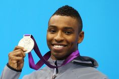 Silver medallist Cullen Jones of the United States poses on the podium during the medal ceremony for the Men?s 50m Freestyle Final on Day 7 of the London 2012 Olympic Games at the Aquatics Centre on August 3, 2012 in London, England.