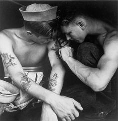 Reminds me of my brother. Much-inked American sailor having another tattoo done by a shipmate aboard the battleship USS New Jersey during WWII. Date taken: December 1944 Photographer: Charles Fenno Jacobs Marine Tattoos, Navy Tattoos, Sailor Tattoos, Nautical Tattoos, Ship Tattoos, Arabic Tattoos, Dragon Tattoos, Vintage Nautical Tattoo, Boat Tattoos
