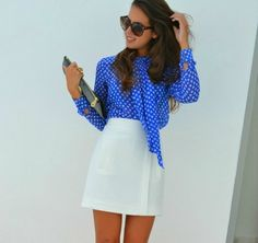 royal blue polka dot blouse with white skirt and clutch