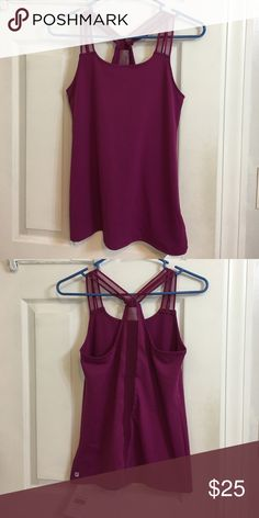 NWT Fabletics Peyton Tank Brand new with tags and never been worn, double mesh straps with mesh line down the back of the tank Fabletics Tops Tank Tops