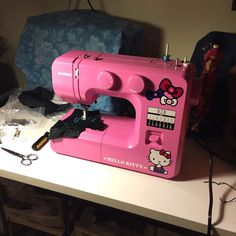 Readers, say hello to the first brand new sewing machine I've ever purchased! It's a Janome, model a lipstick pink Hello Kitty. You may recall from an earlier post that I was curious about what Brother Project Runway, Pink Hello Kitty, Miss Kitty, Vintage Sewing Machines, Pink Lipsticks, Sewing Hacks, Sewing Tips, Janome, Fashion Fabric