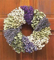 "Lavender Patchwork Wreath, 16"" dia. . $49.95. Lavender Patchwork Wreath, 16"" dia.. Reminiscent of a handmade patchwork quilt, our lavender Wreath is handcrafted on a natural twig base with patches of eucalyptus, white ammobium, larkspur, purple sinuata, phalaris and lovely English lavender. Display in a covered or protected location. Shipping Please allow 2-3 weeks for delivery"