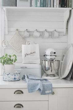 ♕ {kitchen cupboard inspiration: make a peg board like this one to go under the open shelving for our cups}