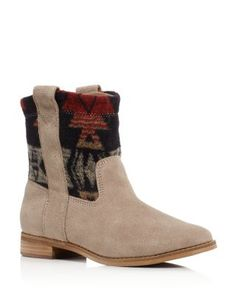 Toms infuses this suede bootie with hints of western flair: a subtle slouch, a slightly curved topline and easy pull tabs. Rock them with everything from airy dresses to skinny jeans to show off their