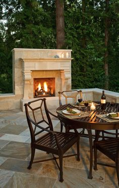 outdoor fireplace in limestone, and love the patio tile pattern too.