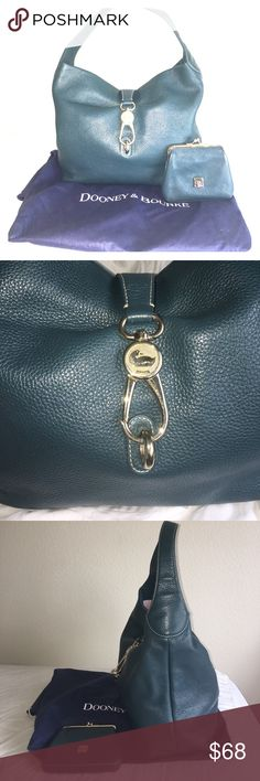 Dooney & Bourke Pebbled Leather Hobo Luxurious deep blue green color is perfected in this pebbled leather hobo with label lock. Comes with coin purse and dust bag! Gently used with minimal signs of wear that only add to the vintage look! Dooney & Bourke Bags Hobos