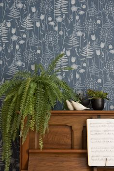 Charlotte's Garden wallpaper in inkwell - a deep inky blue by British designer Hannah Nunn . Shown here with a piano, a fern and some Jane Muir ceramic snowbirds. Wallpaper Calculator, Wallpaper And Tiles, Wallpaper, Blue Wallpapers, I Wallpaper, Floral Wallpaper, Inspirational Wallpapers, Fern Wallpaper, Wallpaper Samples