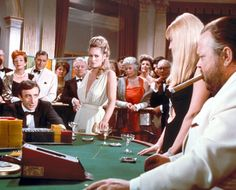 Peter Sellers (one of the James Bonds), Ursula Andress (Vesper Lynd) and Orson Welles (Le Chiffre) in Casino Royale (1967)