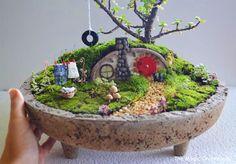 Hobbit garden - More enchanting photos of this magical FAIRY GARDEN on The Magic Onions Blog and FairyGardens.com