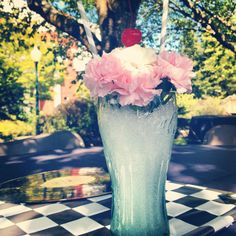 """Super cute """"milkshake"""" centerpiece created by my coworker Aimee for our Rock 'n Roll themed BBQ."""