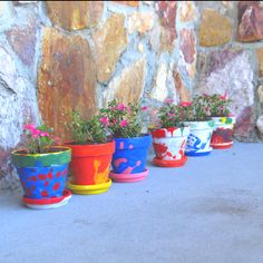 DIY buy or make pot, paint them then use kids feet or hands to decorate! I did whatever their hands are they painted the base of the pot too!!