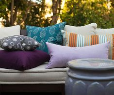 Add Color Smartly on Your Patio - Look for neutrals when buying big couches, rugs, or chairs. Add color and pattern with pillows and accessories to change or update the look. After a few seasons, if you tire of your accessories or they are starting to look a little faded, plan to stock up on new cushions, rugs, and more at end-of-season sales. That way, when spring rolls around again, you'll be ready with a new look purchased on a bargain budget.