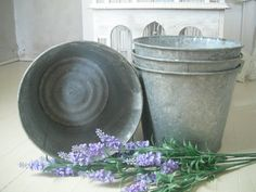galvanized buckets full of flowers along the aisle, on the tables...