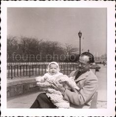 A personal favorite from my Etsy shop https://www.etsy.com/listing/242512644/vintage-photo-man-and-baby-river-view