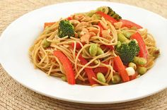 Spicy Edamame Noodle Toss: Whole wheat spaghetti combines with a stir fry of broccoli, carrot, red bell pepper and edamame for a healthy but hearty meatless meal.