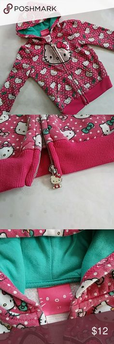 Adorable Hello Kitty Zip Up Hoodie Hello Kitty pink white and teal hooded zip up sweatshirt.  Cute little Hello Kitty zipper emblem, pink w/ white polka dots & hello kitty wearing pink orange and teal bows?????? Hello Kitty Shirts & Tops Sweatshirts & Hoodies
