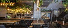 View the full picture gallery of 416 Vegan Restaurant-Tel Aviv- Israel Restaurant Layout, Restaurant Interior Design, Exposed Concrete, Concrete Floors, Portal Office, Tel Aviv Israel, Dramatic Lighting, Vegan Restaurants, Pendant Light Fixtures
