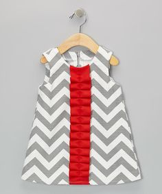 Jazzed with zigzags and a colorful frill accent, this soft cotton piece adds a lively touch to a little lady's wardrobe. The half-zipper in back makes dressing as easy as pie.