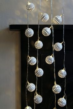 Use this beautiful Maroq LED light chain to decorate your house all year round. The line of pretty Moroccan inspired decorations hang on a line of lights [featuring 24 maroq orbs]. The full length including extra wire to the plug is and comes wit Indoor Christmas Tree Lights, White Artificial Christmas Tree, Xmas Lights, Copper Wire Lights, Cluster Lights, Rockett St George, Light Chain, Types Of Lighting, Tree Lighting