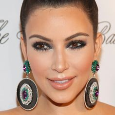 Seriously Smoky: Intimidated by the smoky eye? Achieving Kim Kardashian's super dramatic effect is easier than you think. Blend shadows in varying degrees of darkness, starting with the richest near the lash lines, and continue until sexy. Simplify the process by picking up a palette of like-colors designed specifically for layering.