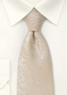 Tired of solid or striped ties for your big day? How about this paisley design in elegant hues of ivory, cream, and champagne. #WeddingIdeas