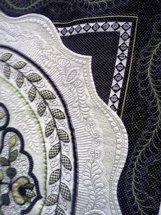 Black and white.Gorgeous quilt work and machine quilting design. Created by a true artist.