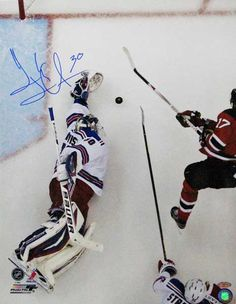 Henrik Lundqvist signed Sprawling Save 16x20 photo.