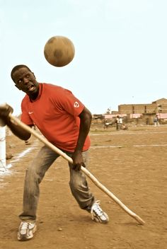 Francis, a polio survivor, heads a ball on the pitch in Nairobi town, Kenya.