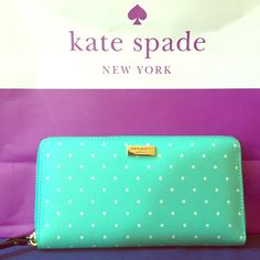 "Kate Spade Grant Street Neda Wallet Synthetic Zip closure Continental wallet crafted in saffiano textured grainy vinyl kate spade new york license plate. Back exterior slip pocket. Zip around closure. Center zip change pocket, 3 bifolds, 12 credit card slots 8""w x 4""h x 0.8""d Color: Fresh Air/Cream Dots kate spade Bags Wallets"