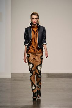 copper silk top, blue leather blazer and leather pants ornated with art deco patches and rivets