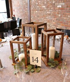 Jaime Costiglio of Jaime Costiglio got creative with her latest DIY project. Instead of using floral centerpieces Jaime created beautiful wooden lanterns for her friend?s wedding reception. This simple project added a lot of character. Read on to see t Wedding Table Centerpieces, Wedding Flower Arrangements, Wedding Table Numbers, Floral Centerpieces, Centerpiece Ideas, Diy Wedding Lanterns, Wooden Wedding Centerpieces, Lanterns For Weddings, Wedding Flowers