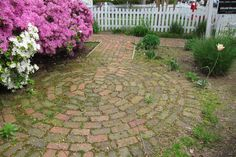 A salvaged-brick circle in front was modeled after a French garden.