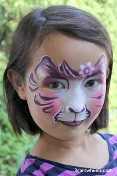 Wild Flower Kitty. Three Cartwheels face painting.