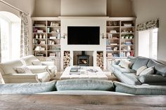 Wood burner & TV combination.  Open shelves may show too much clutter so would change to be enclosed