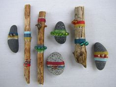 Sticks and Stones  Sea stones and sticks wrapped and beaded This would make a cool instrument basket! I want to make these with jingle bells to have more interest in the bells since we have so many. I might even have these in a basket in the room out all the time...they are beautiful!