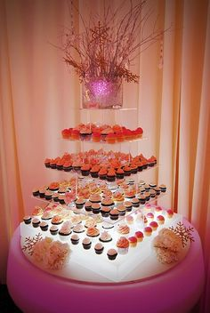 Pink and orange modern cupcake tower display #cupcake #wedding #weddingcupcake #cupcaketower #modern