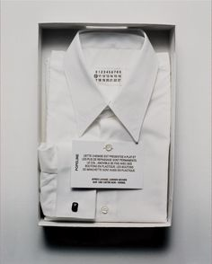 2db6b7ce5864d Disposable info card buttoned onto front of garment (explaining NFC and QR  use)