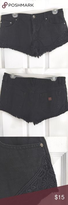 Black Denim Roxy Shorts Frayed on the bottom with crochet detailing on the bottom corners. Fastens with four buttons in the front. Size 28 converts to about a size 4-5 in Junior's. Roxy Shorts Jean Shorts