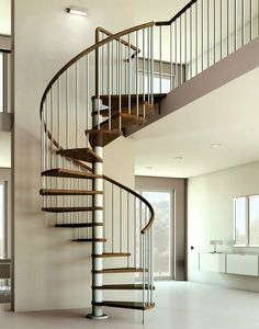 Beautiful stair lighting, elegantly simple. escalier en colimacon bois et chrome