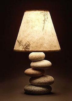Balance Rock Lamp 175.00 USD - simple, natural lamp, perfect for a minimal look, meditation room, . . . an office with all its accompanying computer equipment because in feng shui, earth (stone) balances fire (electronics). From Mark Guido, Timberstone Rustic Arts (Mainerockguy on etsy)