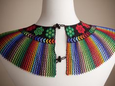 The beautiful Pavo Real necklace is handmade by the women of the La Mega cooperative in Ecuador. This piece is named after a peacock, but the design represents the sacred matizado pattern; a color-ble African Necklace, African Beads, Native Beadwork, Beaded Collar, Seed Bead Necklace, Beaded Necklace, Beaded Jewelry Patterns, Bead Weaving, Beautiful Necklaces