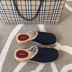 Burberry shoes clogs mules 39 denim authentic Gorgeous Burberry denim + wood clogs in size 39 with Burberry check lining in inside and red leather logo on foot sole. Beautiful, 100% authentic, adorable, fantastic condition. Classic designer shoes, priced very fairly considering how special they are  Burberry Shoes