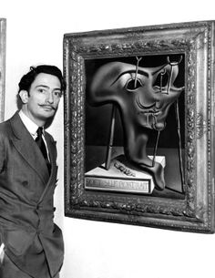 Salvador Dali, showing off his piece entitled 'Soft Self Portrait' at the Julien Levy Gallery in New York, ca. 1941