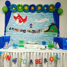 Transportation theme birthday party with handmade flowers, airplane, name banner.