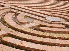 This water maze is beautiful when filled with rainwater. It is distinctive because it is a Chartres Maze. This special type of maze is based upon Christian mythology, and it features a clear cross-like symbology (at right, below) which the believer is meant to walk in a particular pattern